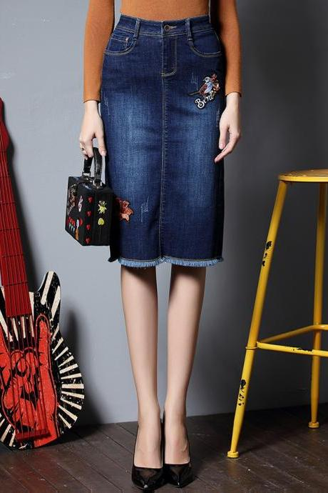 Embroidered Dark Washed Knee Length Denim Skirt Featuring Raw Hem
